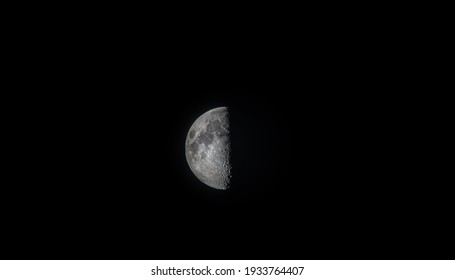Isolated first quarter moon in the dark