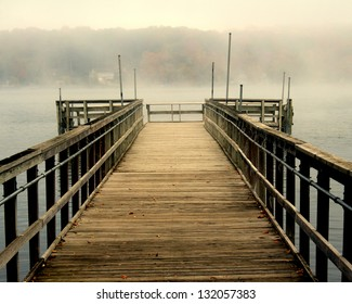 An isolated fishing pier on a misty morning in Wisconsin
