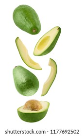 Isolated flying avocado. Falling fresh avocado isolated on white background with clipping path as package design element and advertising.