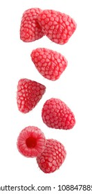 Isolated flying berries. Falling raspberry fruits isolated on white background with clipping path as package design element and advertising.
