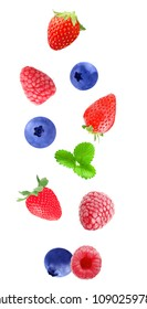 Isolated flying berry fruits. Falling strawberry, blueberry and raspberry fruits  isolated on white background with clipping path as package design element and advertising.