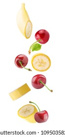 Isolated flying fruits. Falling banana and cherry fruits isolated on white background with clipping path as package design element and advertising.