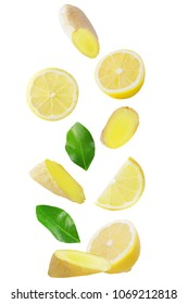 Isolated flying fruits. Falling lemon and ginger isolated on white background with clipping path as package design element and advertising.