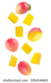 Isolated flying fruits. Whole and cubes falling mango fruit isolated on white background with clipping path as package design element.