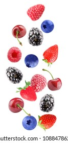 Isolated flying mixed berries. Falling blackberry, cherry, strawberry, raspberry and blueberry fruits isolated on white background with clipping path as package design element and advertising.