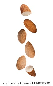 Isolated flying nuts. Falling almonds isolated on white background with clipping path as package design element and advertising.