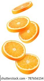 Isolated flying oranges. Falling sliced orange fruit isolated on white background with clipping path