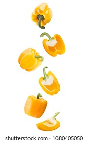 Isolated flying vegetables. Falling sweet yellow peppers isolated on white background with clipping path as package design element and advertising.