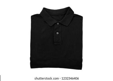 isolated folded black polo shirt on white background
