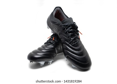 isolated football stud shoes on white background
