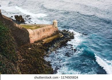 Isolated Fort watchtower (Garita del Diablo) along the coastline in the Castillo (castle) de San Cristobal in San Juan, Puerto Rico