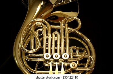 Isolated French horn on black background