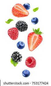 Isolated fresh berries in the air. Falling blackberry, raspberry, blueberry, strawberry fruits and mint leaves isolated on white background with clipping path