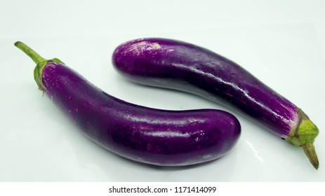 isolated Fresh brinjals is delicious for cuisine in the white background