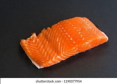 Isolated fresh raw salmon filet on black background