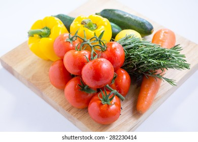 Isolated fresh vegetables on cutting board