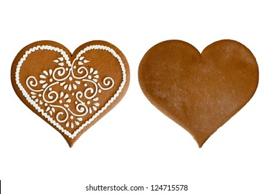 Isolated front and back Christmas gingerbread heart at white background. Blank and icing decorated.