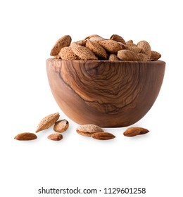 Isolated fruits. Wooden bowl full of almonds with shell  isolated on white background with clipping path as package design element and advertising.