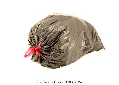 isolated full black garbage plastic bag in white background. Rubbish sack