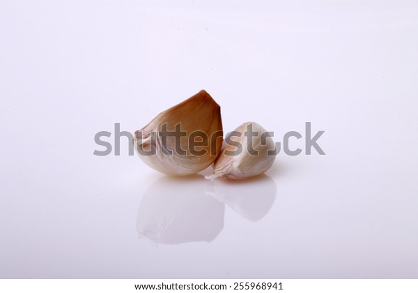 Isolated Garlic clove on grey background