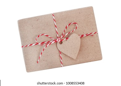 Isolated Gift wrapped on a craft paper and decorated heart