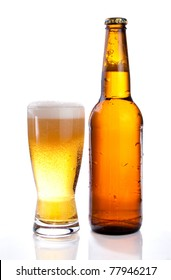 Isolated Glass and Brown bottle of beer on a white background
