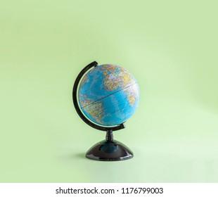 isolated globe model on green background