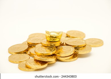 Isolated gold coin and bar, symbol of wealth and prosperity for business or financial background