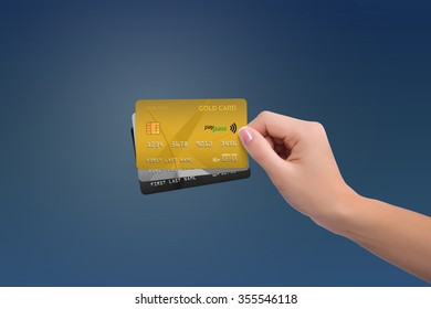 Isolated gold and two more cards in woman hand