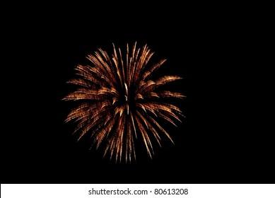 Isolated Golden Yellow Firework Burst against Black Sky