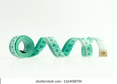 isolated green measuring tape on a white background