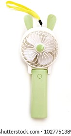 isolated green mini pocket fan on white background