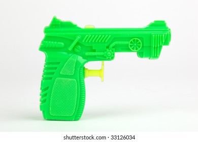 Isolated green toy water pistol.