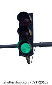 Isolated green traffic light over a white background.