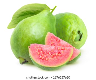 Isolated guava. Two green whole guava fruits and two slices with pink flesh isolated on white background with clipping path