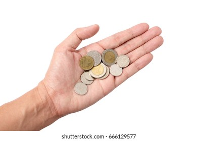 Isolated of hand hold Thai baht coins currency of Thailand on a white background.