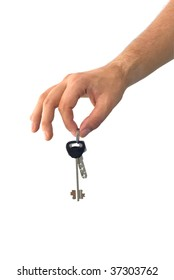 isolated hand holding keys from a house