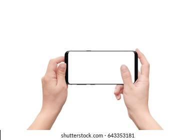 Isolated hand and mobile phone. Woman holding modern smart phone with isolated screen for mockup.
