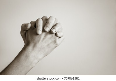 Isolated hand praying. Religion concept.
