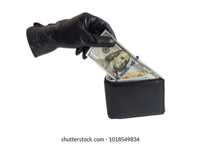 Isolated hand and purse with money. The thief steals a note of $ 100.