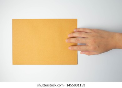 Isolated hand send (submit or put) brown letters (mail, document, notation, monograph, note or paper) on white background.