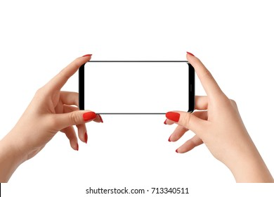 Isolated hands holding modern smartphone with empty screen. Female hands holding modern phone with isolated screen for mockup. Modern black phone with rounded edges