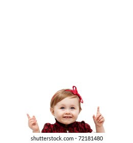 Isolated happy baby girl pointing up and above