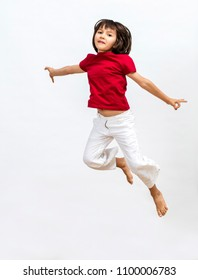 isolated happy beautiful young girl jumping and flying high to express freedom, open mindedness, imagination, happiness and joy over white background