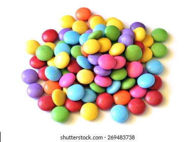 Isolated heap of colored smarties on white background