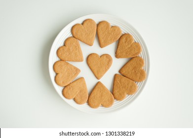 Isolated heart shape cookies on white plate