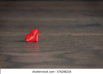 Isolated heart with a wood background