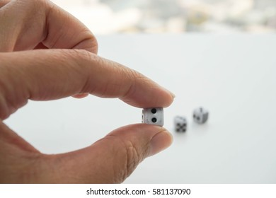 isolated hold a dice with left hand
