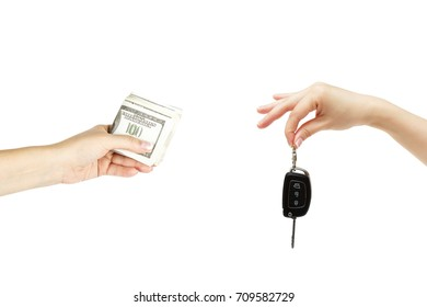 Isolated holding hands with car keys and stack of dollars on white background.