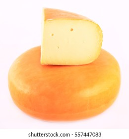 Isolated Holland Gouda cheese on a white background
